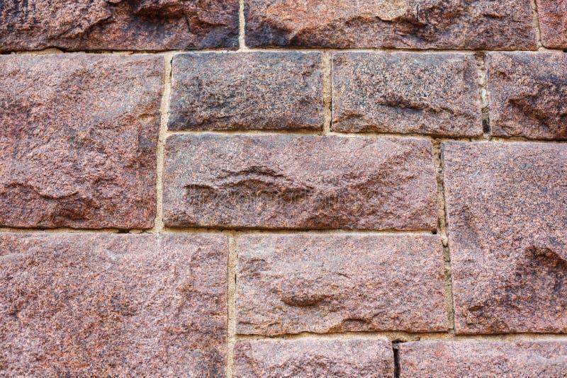 Revêtement rouge de mur de maçonnerie de granit photo libre de droits