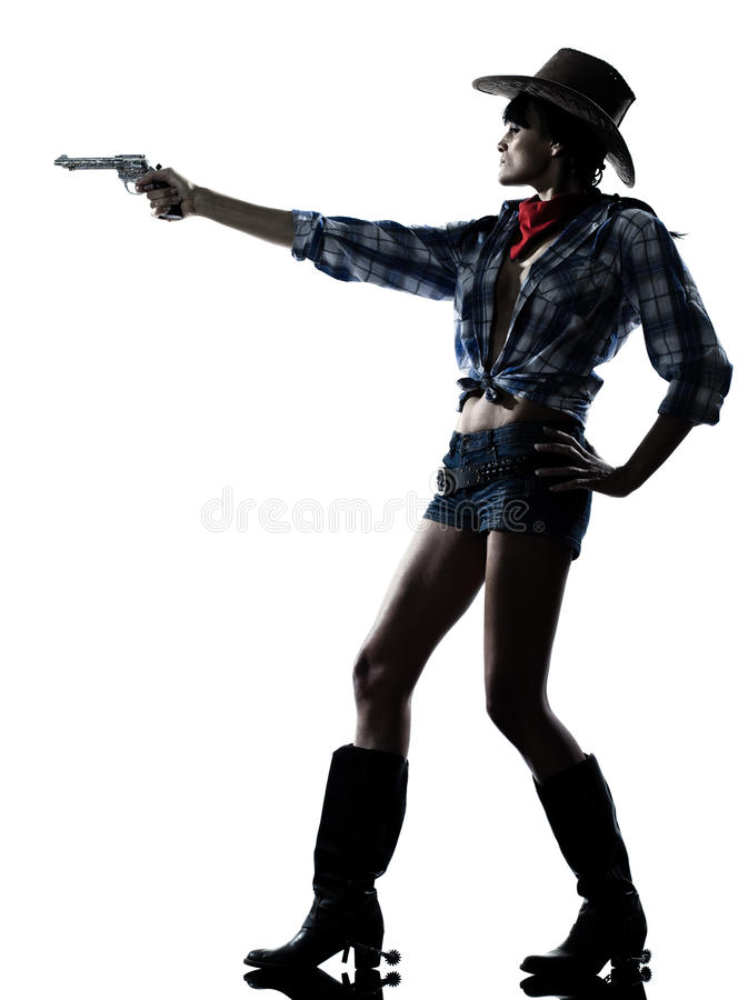 Revólver del arma del shooting del cowgirl de la mujer imagen de archivo