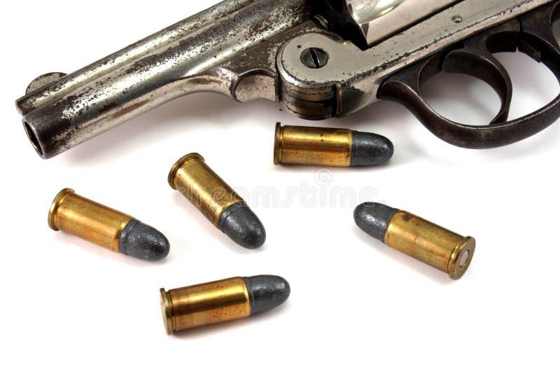 Revólver e balas imagem de stock royalty free