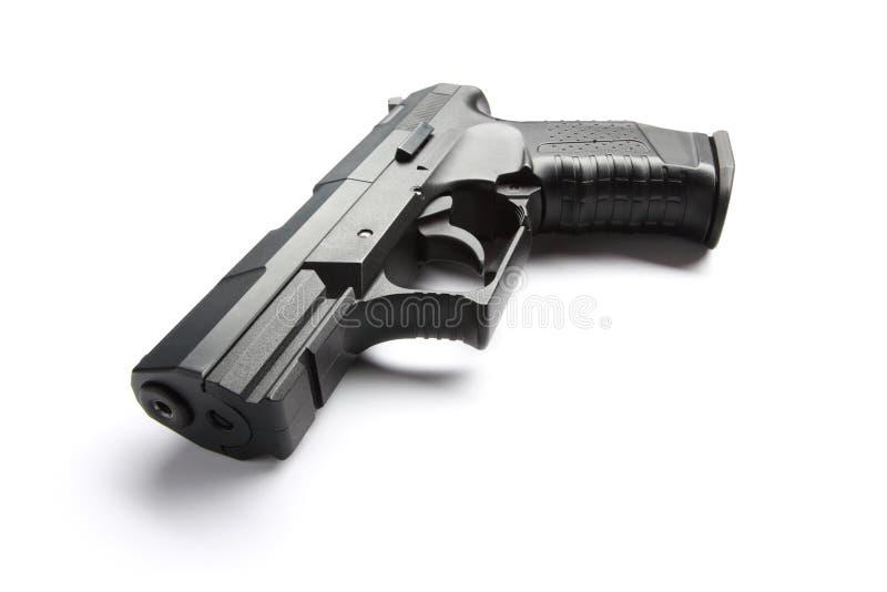 Revólver preto no branco fotografia de stock