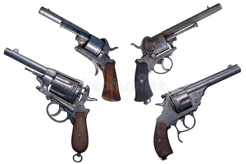 Revólveres antigos Arma quatro velha isolada imagens de stock
