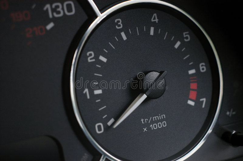 Rev counter on new car royalty free stock photo