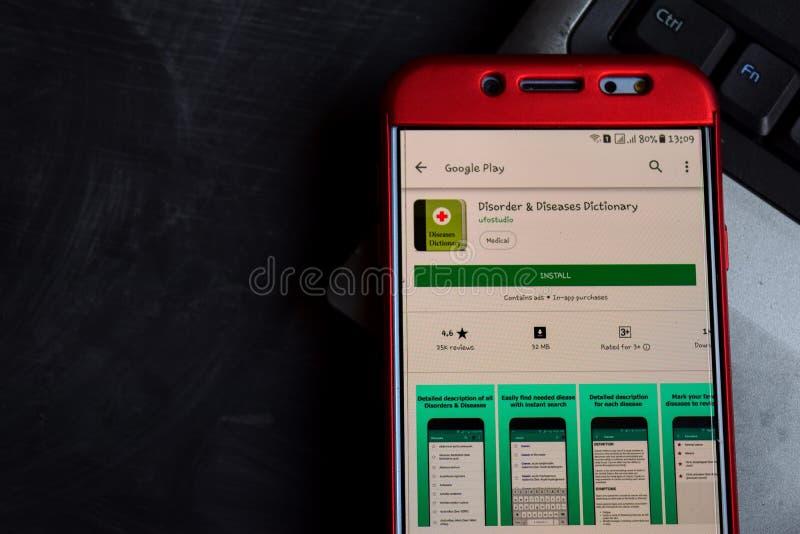 Revelador app del diccionario del desorden y de las enfermedades en la pantalla de Smartphone foto de archivo libre de regalías