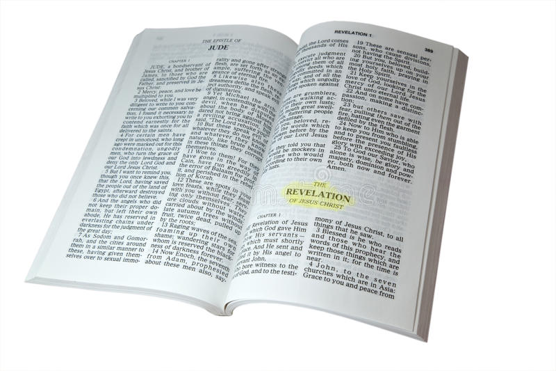 Revelation of Jesus Christ. Open bible at the book of Revelation isolated on white background stock images