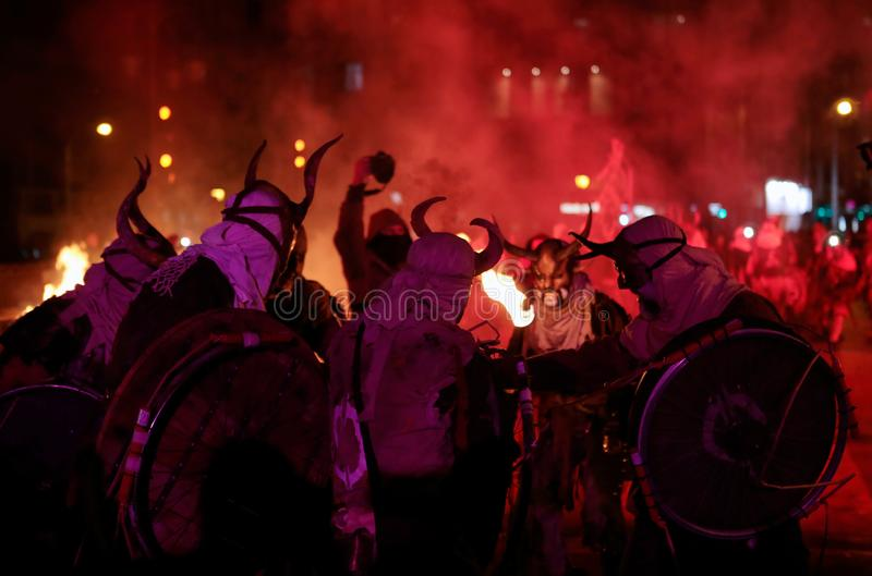 Correfoc in palma during saint sebastian local patron festivities. Revellers dressed as devils and holding fireworks take part in a traditional Correfoc fire run royalty free stock images