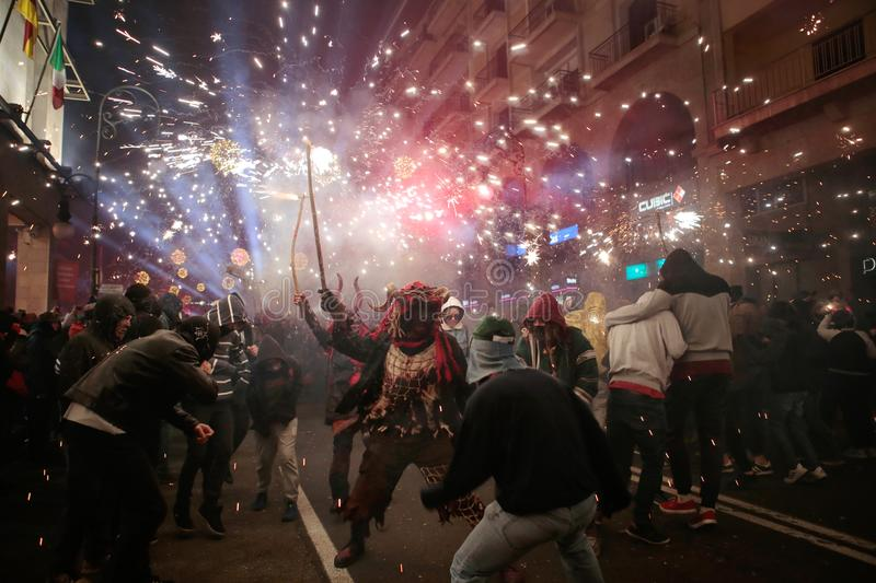Revellers during saint sebastian local patron festivities. Revellers seen during a traditional Correfoc fire run in Palma de Mallorca. correfoc is a traditional royalty free stock photos