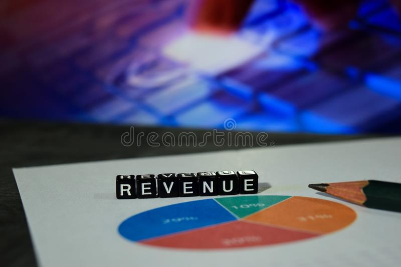 Revenue on wooden blocks. Money Investment Research Data Concept stock photography
