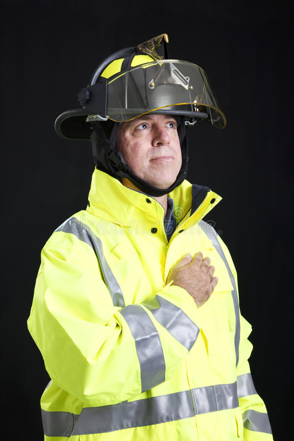 Download Reverent Firefighter stock photo. Image of helmet, middle - 19566688