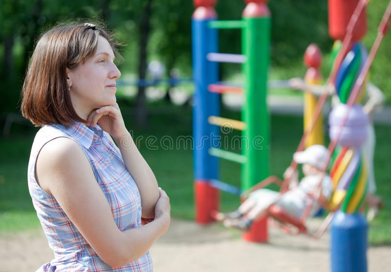 Download Reverie  Woman Against  Playground Stock Photo - Image: 25207624