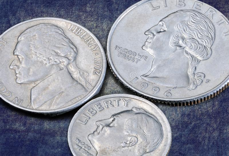 Reverse of the coins 25, 10 and 5 US cents. US coins of a quarter dollar, one dime and five cents on a dark blue background. Reverse of the coins 25, 10 and 5 US stock photo