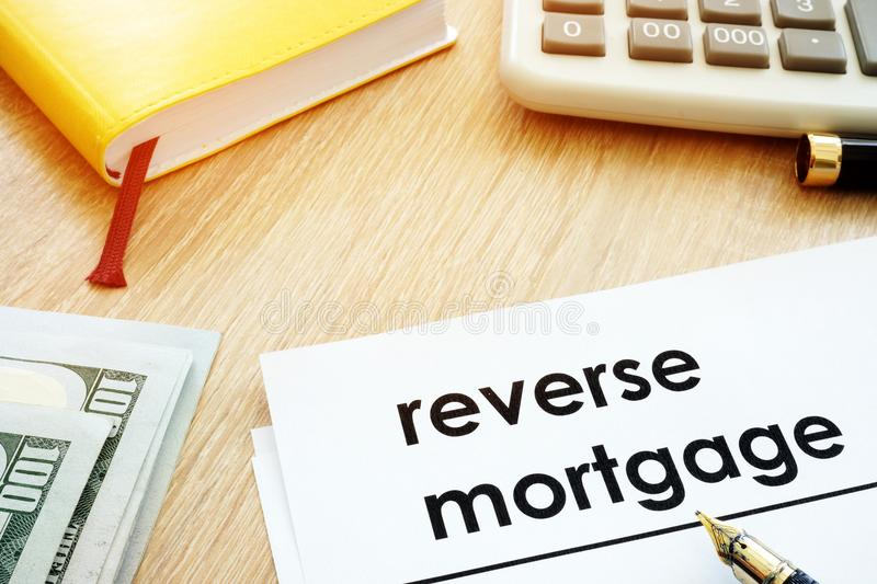 Reverse mortgage concept. Documents and calculator on a desk. stock photos