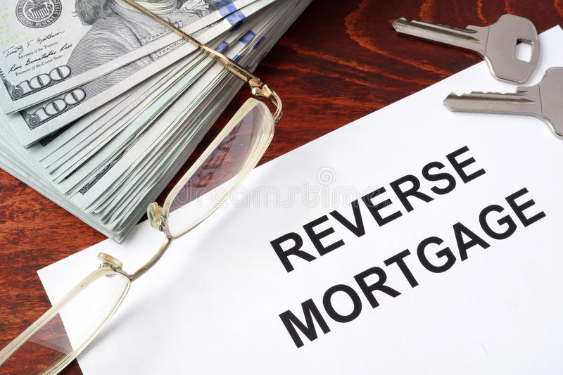 Reverse mortgage form. Reverse mortgage form on a table and money stock images