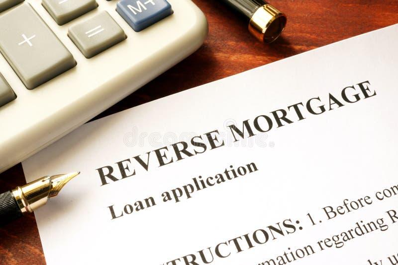 Reverse mortgage loan application. Reverse mortgage loan application on a table royalty free stock image