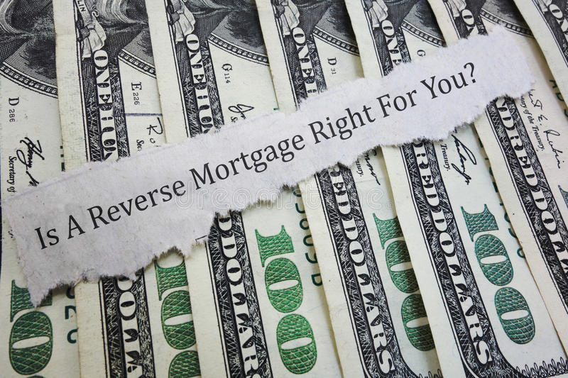 Reverse mortgage question. Reverse mortgage headline on money royalty free stock photos