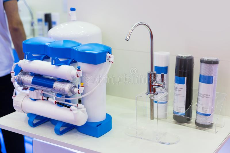 Reverse osmosis, water cleaning filter. Exhibition stand. Filtration system, water purification stock photos