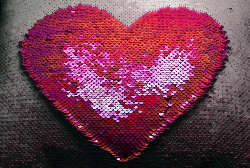 Reversible sequins. Pink and white with heart design. stock images