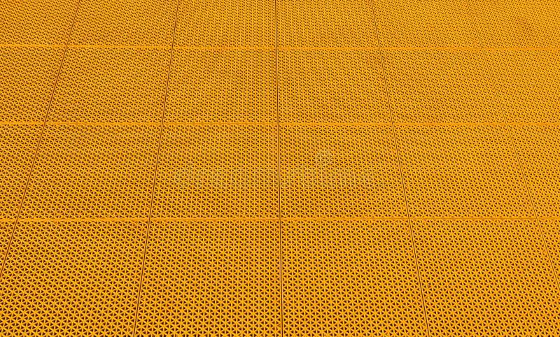 Revestimento de borracha amarelo no fundo do campo de Futsal imagens de stock