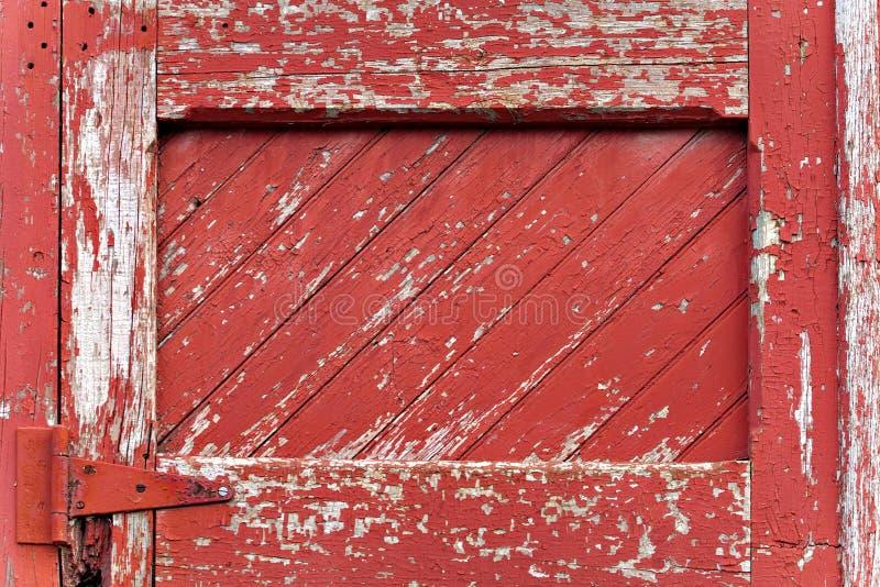 Revestimiento de madera de madera pintado rojo fotos de archivo