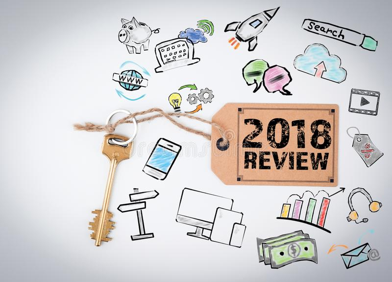 2018 review Concept. Key and a note on a white background stock photography