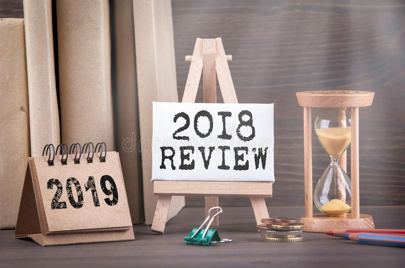 2018 review concept. Sandglass, hourglass or egg timer on wooden table stock photo
