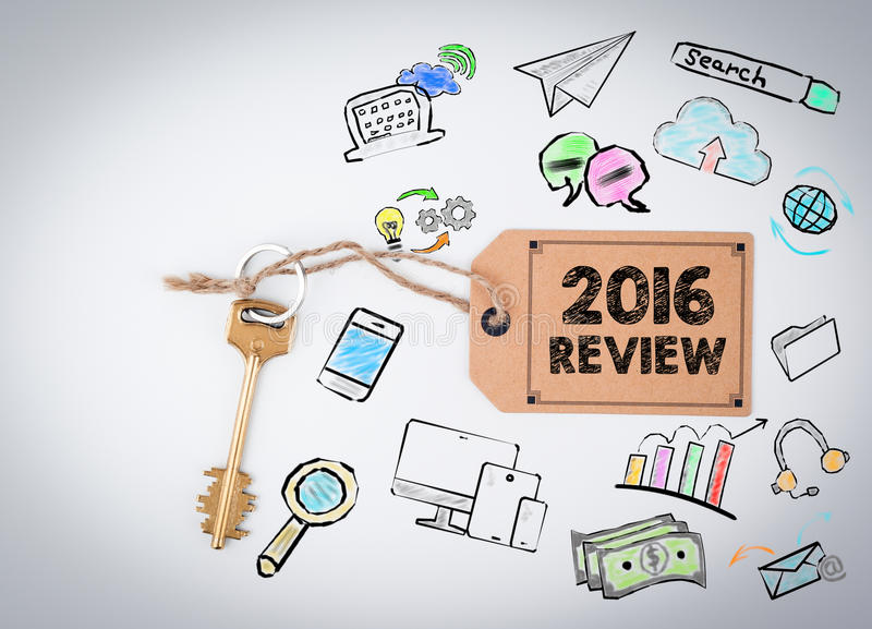 2016 Review. Key on a white background. 2016 Review. Key and a note on a white background royalty free stock images