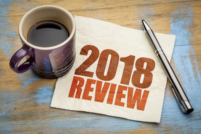 2018 review on napkin. 2018 review text on a napkin with a cup of coffee stock image