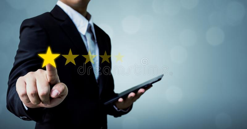 Review and rating increase company concept, Businessman hand touching five star royalty free stock image
