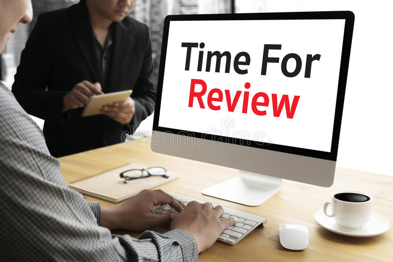 Review time Business Concept , time for review , Business tea. M hands at work with financial reports and a laptop royalty free stock photo