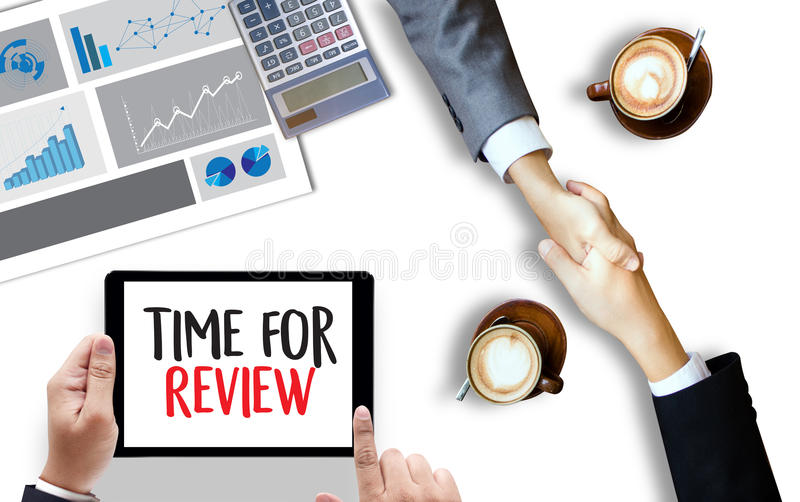Review time Business Concept , time for review , Business team h. Ands at work with financial reports and a laptop royalty free stock photography