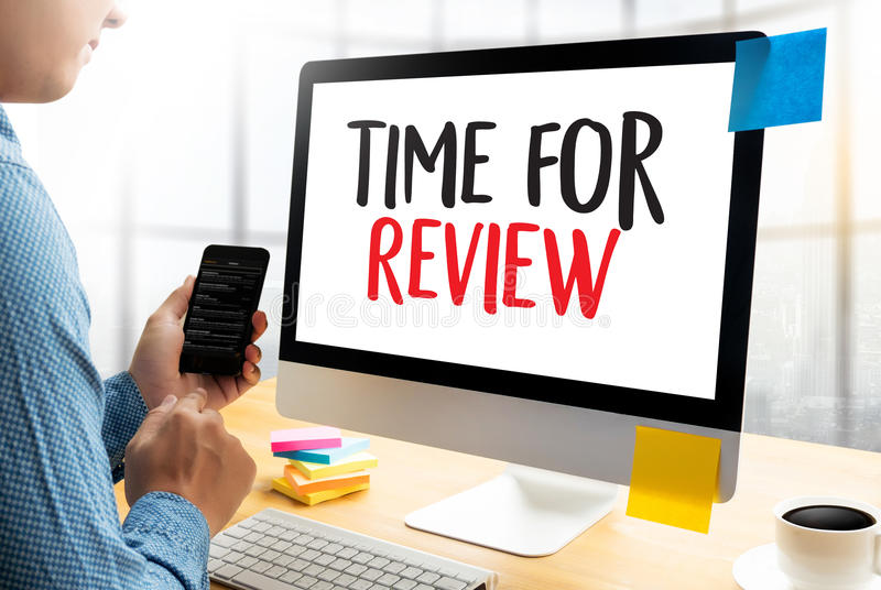 Review time Business Concept , time for review , Business team h. Ands at work with financial reports and a laptop royalty free stock image