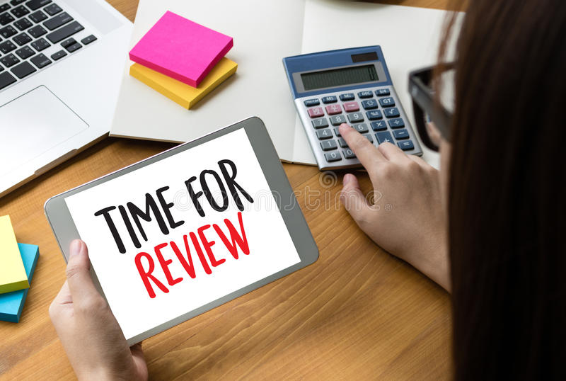 Review time Business Concept , time for review , Business team h. Ands at work with financial reports and a laptop royalty free stock photo