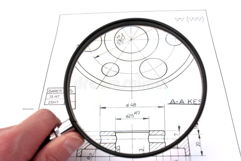 Reviewing technical drawing. Focus on drawing. royalty free stock photography