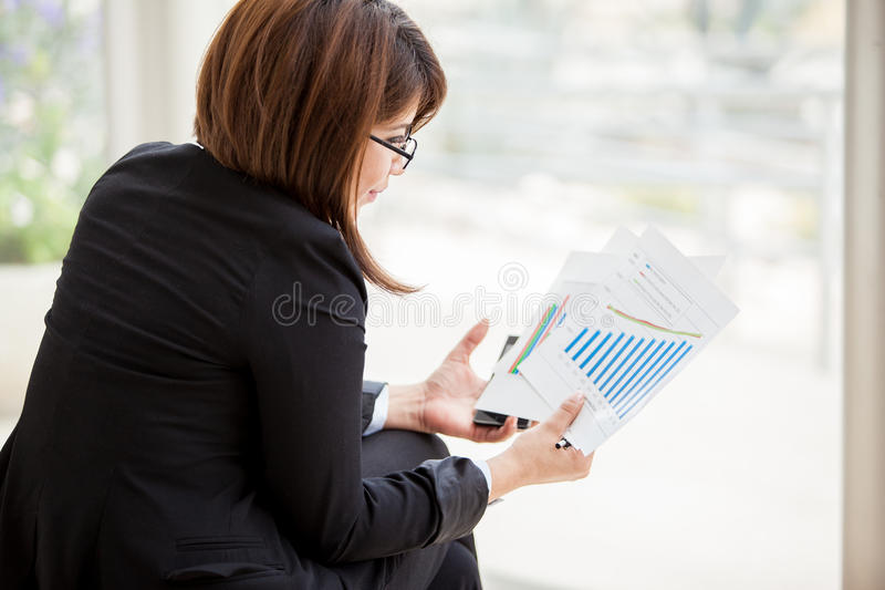 Reviewing work performance stock images
