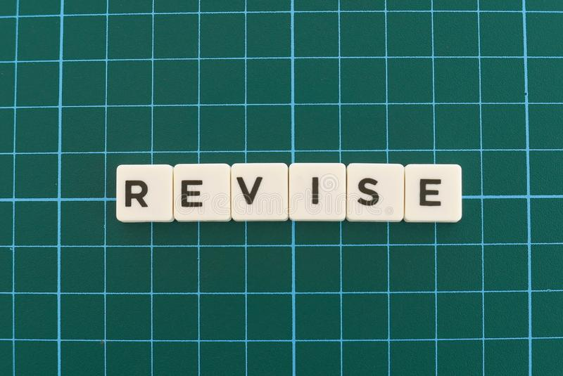 Revise word made of square letter word on green square mat background. Check review text dictionary revision business evaluation analysis inspection definition stock photos