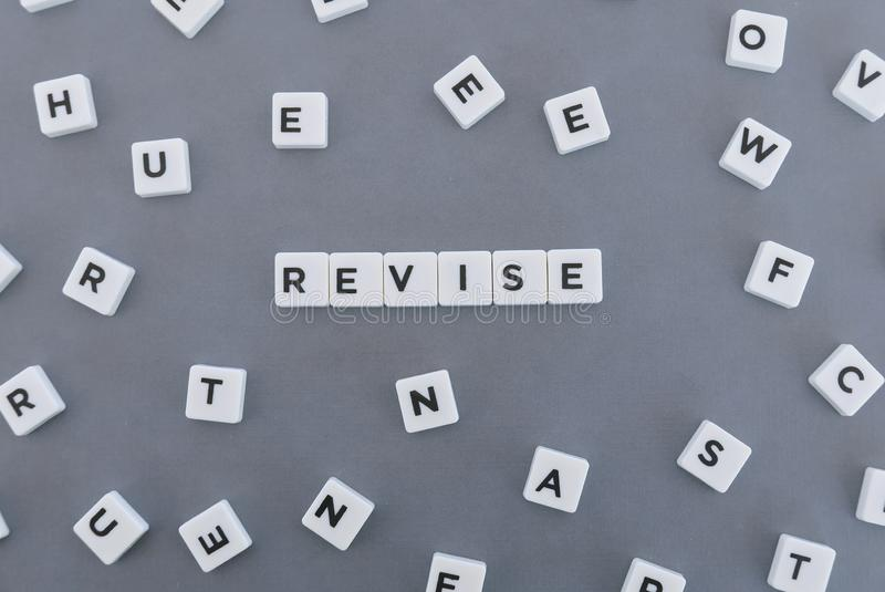 Revise word made of square letter word on grey background. Check review text dictionary revision business evaluation analysis inspection definition reference royalty free stock photos