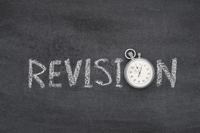 Revision word watch. Revision word handwritten on chalkboard with vintage precise stopwatch used instead of O stock photos