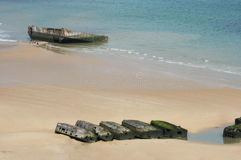 Revisiting D-Day. View on Mulberry harbour at Arromanches, Normandy, France, with the remains of the artificial harbour, used on D-Day in World War II stock photography