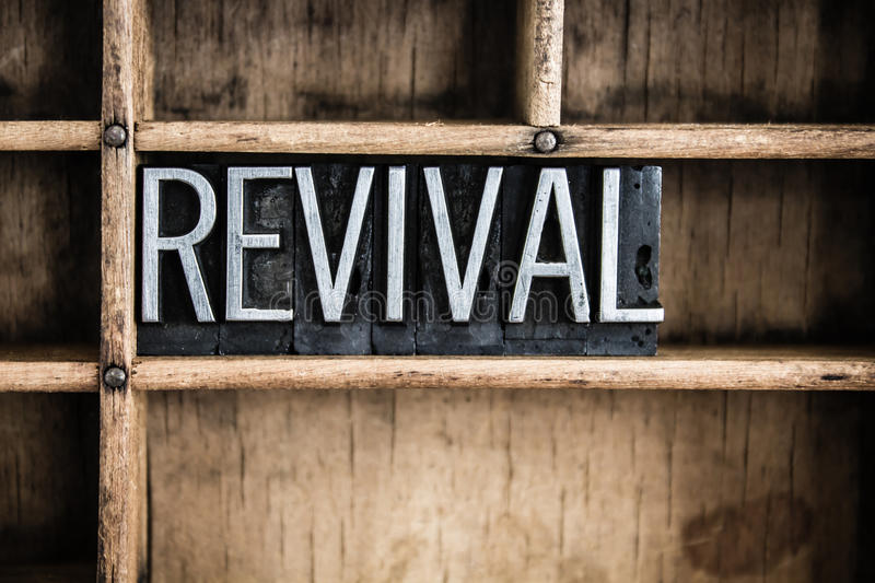 Revival Concept Metal Letterpress Word in Drawer. The word REVIVAL written in vintage metal letterpress type in a wooden drawer with dividers stock image