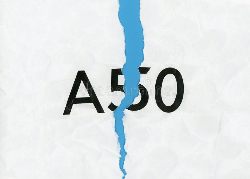 Revoke A50 (Article 50) and remain in the EU. Torn paper with word A50 representing the growing request to revoke Article 50 to stop Brexit and remain in the EU stock photography