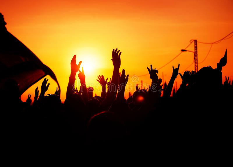 Revolution. People protest against government, man fighting for rights, silhouettes of hands up in the sky, threat of war stock photo