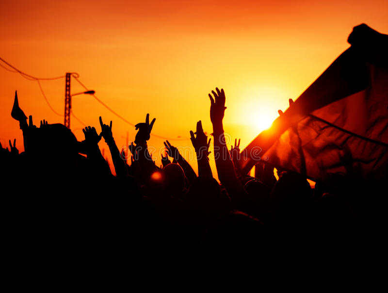 Revolution. People protest against government, man fighting for rights, silhouettes of hands up in the sky, threat of war royalty free stock photography