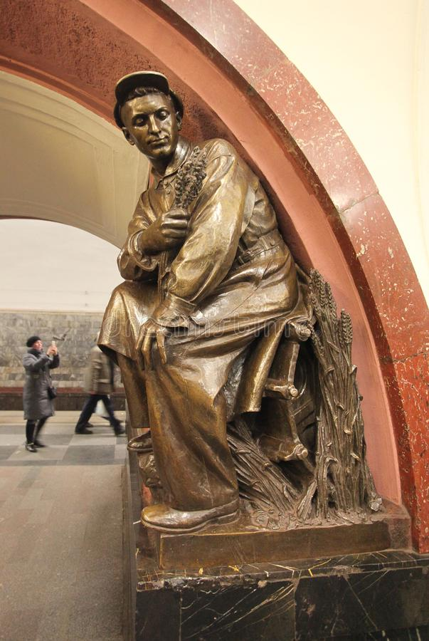 Revolution Square metro station in Moscow. Revolution Square is one of the most famous metro stations in Moscow with many bronze statues inside depicting stock photos