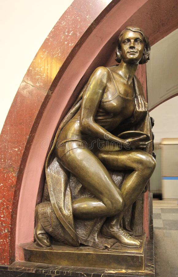 Revolution Square metro station in Moscow. Revolution Square is one of the most famous metro stations in Moscow with many bronze statues inside depicting royalty free stock photo