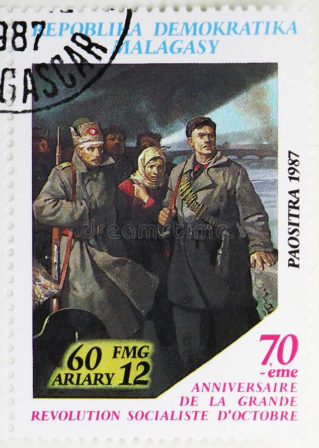 Revolutionaries, 70th Anniversary of October Revolution serie, circa 1988. MOSCOW, RUSSIA - JULY 25, 2019: Postage stamp printed in Madagascar shows stock photos