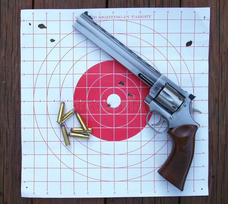 Download Revolver, bullets & target stock photo. Image of bullseye - 63538