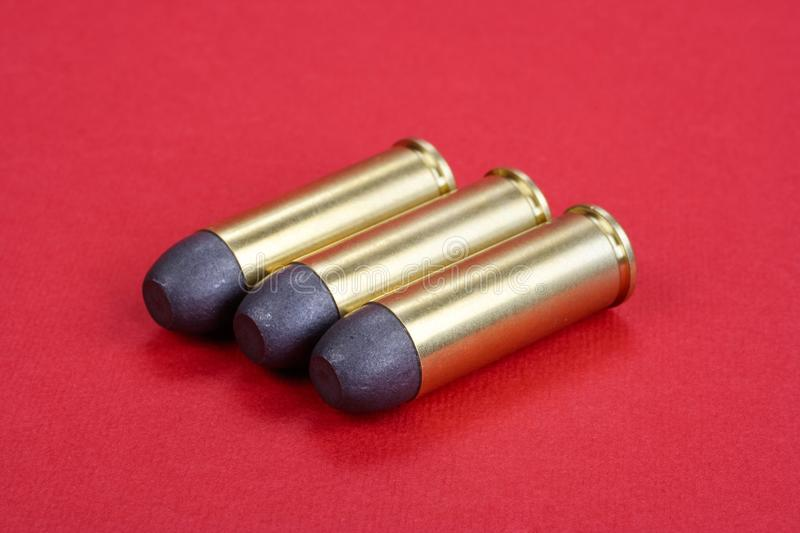 The .45 Revolver cartridges dating to 1872. On red background royalty free stock photo