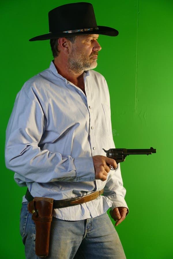 Revolver de chapeau noir de cowboy image stock