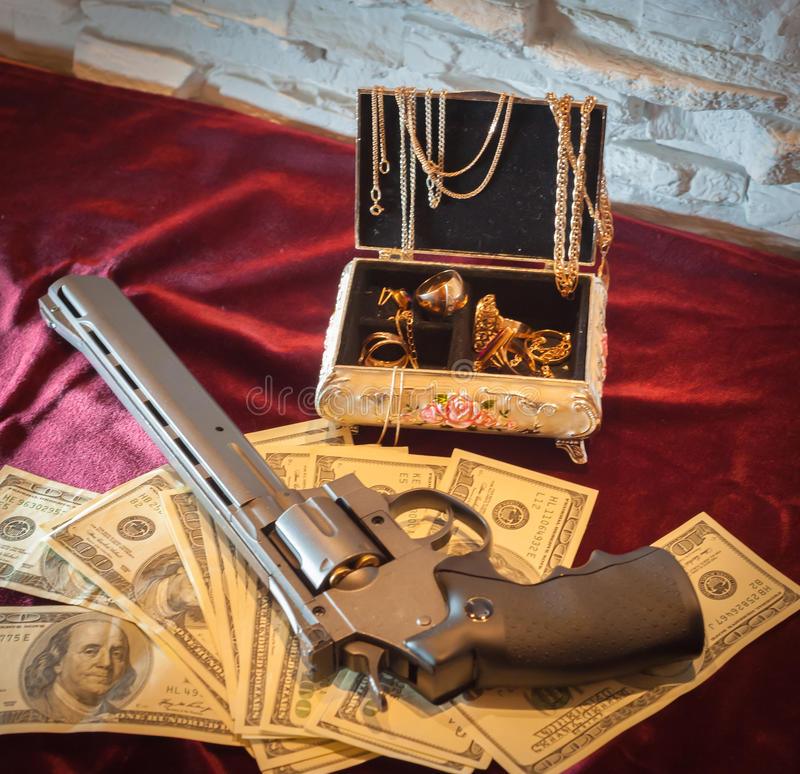 Revolver, gold jewelry Russian criminal stock image