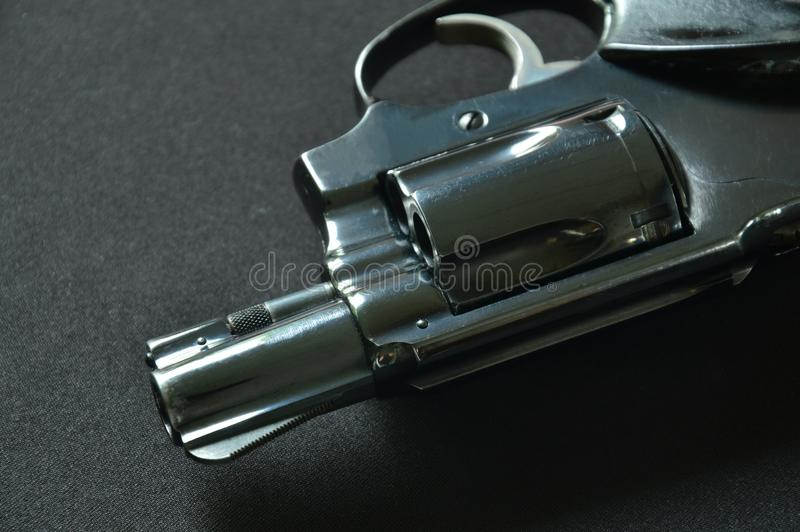 Revolver gun on black fabric background royalty free stock images