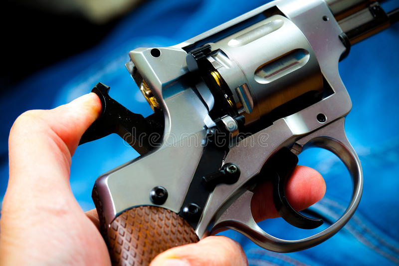 Revolver in human hand royalty free stock image